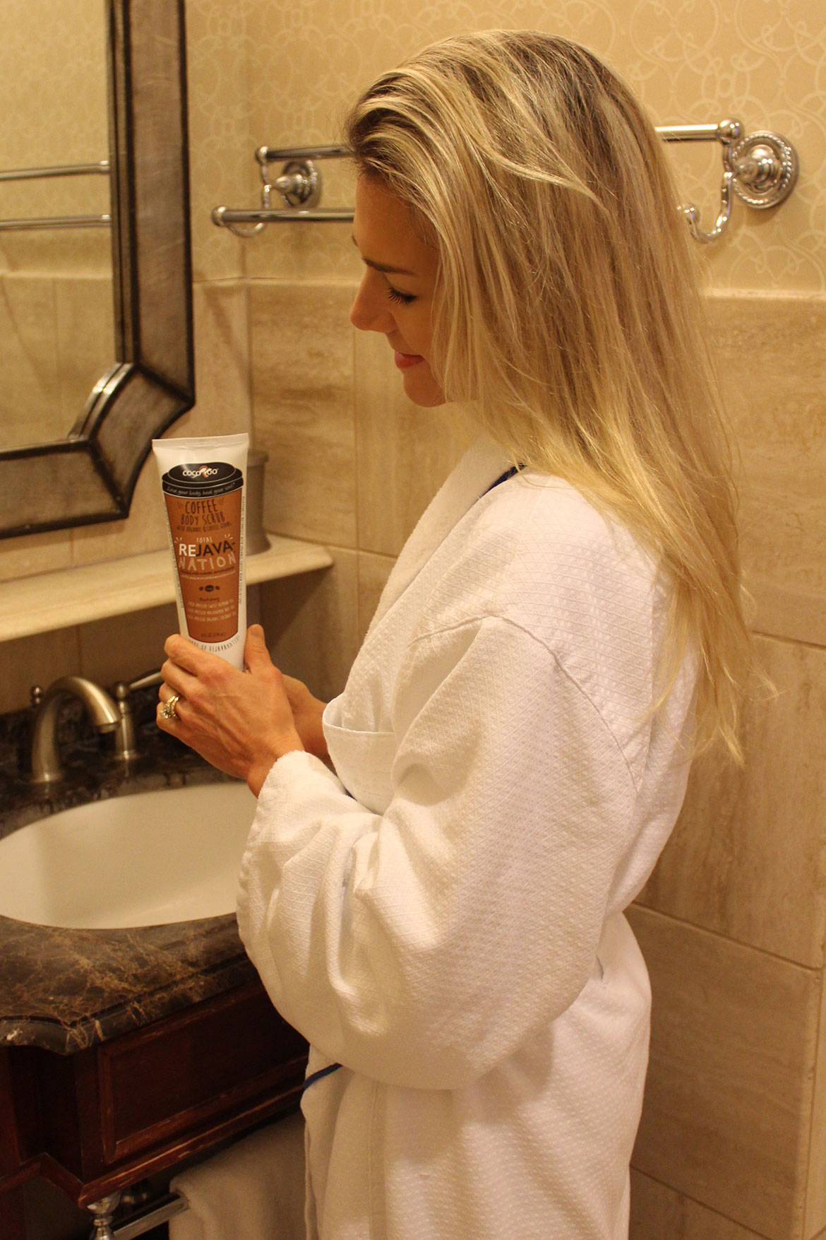 Deba Wilson Using an Organic Coffee Scrub Exfoliator When Traveling