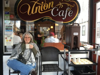 Lisa enjoying a fresh cup of coffee as we waited to be seated for brunch.