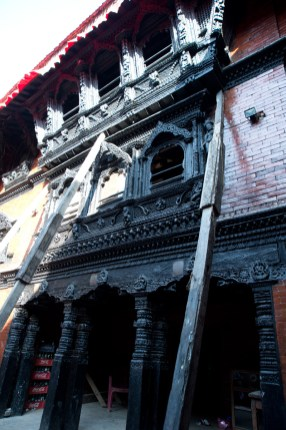 Some parts of the temple are destroyed by the earthquake and poles are used to support the building now