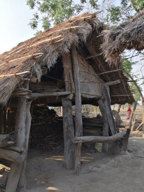 Their houses are constructed of local materials like mud, wood and grass.