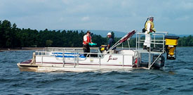 Bayluscide being distributed from boat during a lamprey control treatment on a delta.