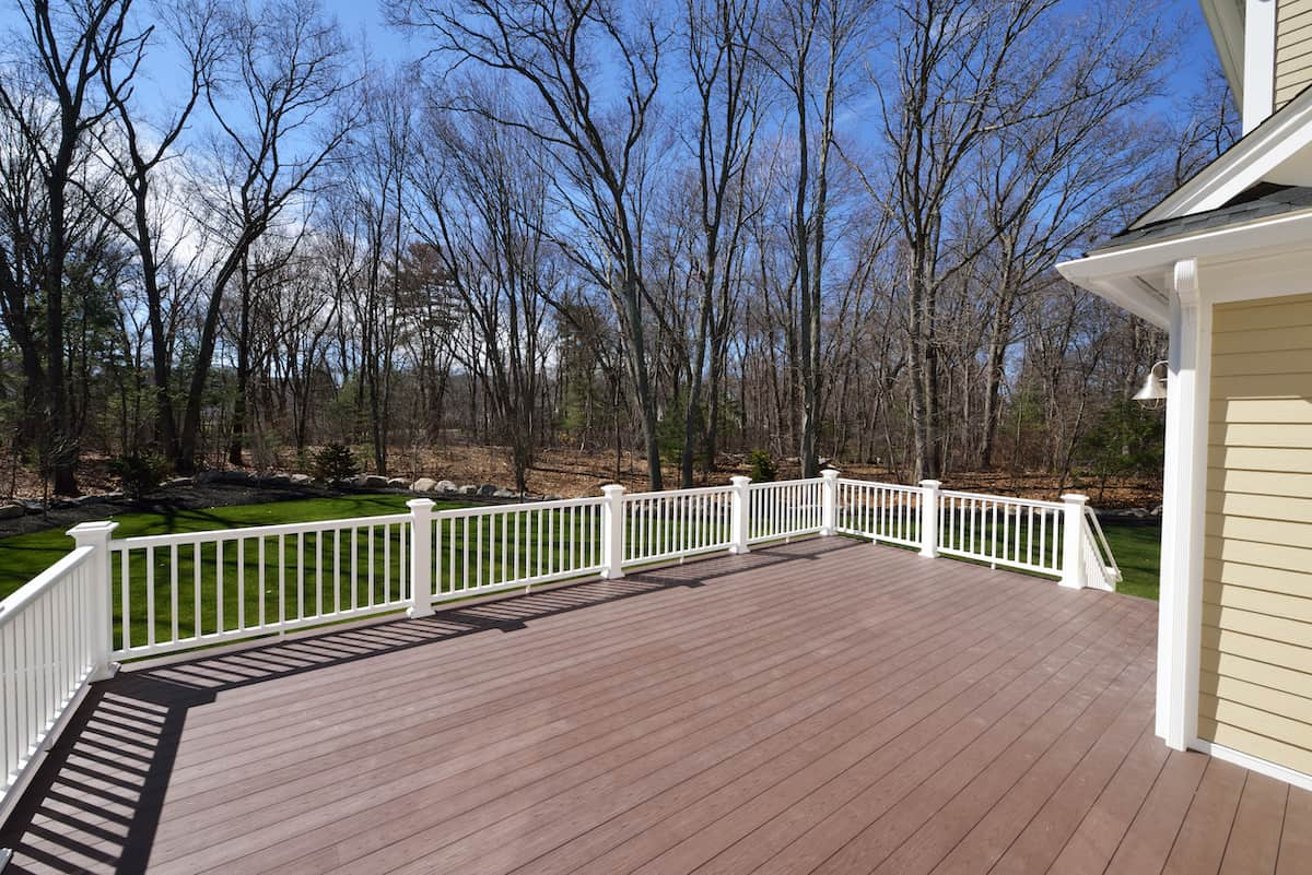 how to install deck railing posts
