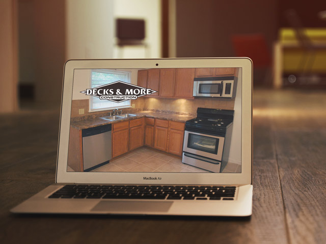 Laptop showing kitchen remodel