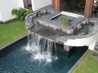 Charming Waterfalls for Pools to be Amazed By | Decohoms