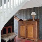 Casas con encanto un refugio revestido en madera con toques étnicos 6
