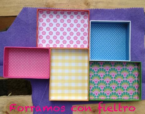 manualidad niños 7 DIY: Una estantería con tapas de cajas empapeladas by Terrón de Azúcar