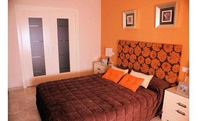 Pintar un dormitorio de color naranja