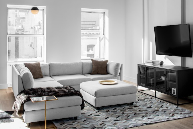 grey living room area rugs ideas for wall art 15 ways to style a sofa in your home decor aid rug