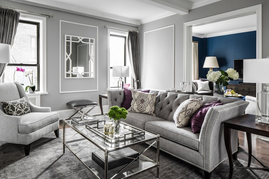 transitional style living room dark blue sofa a chicago apartment for newlyweds luxurious 2 3x