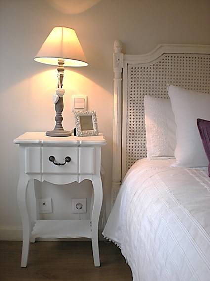 Un dormitorio decorado por Chic Attique