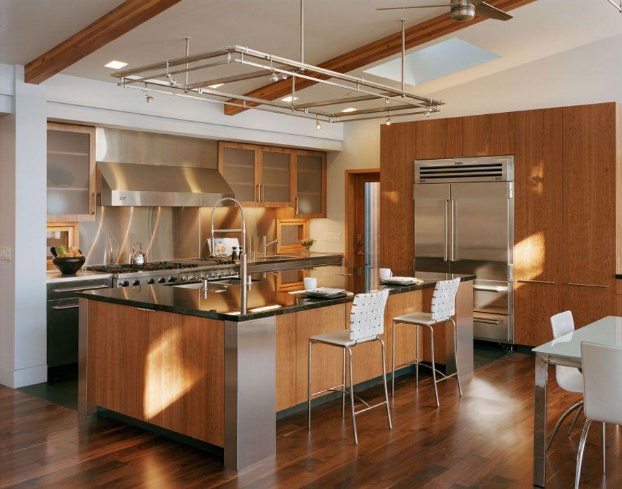 Diseo de Casa con varios elementos de Madera por Kaplan Architects