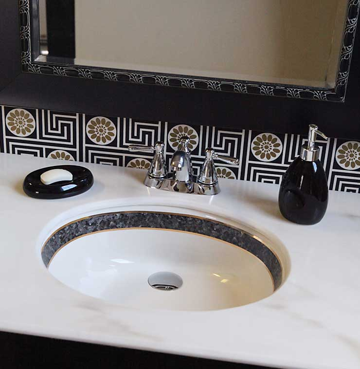 Faux black marble border and gold trim painted sink on Kohler Caxton.