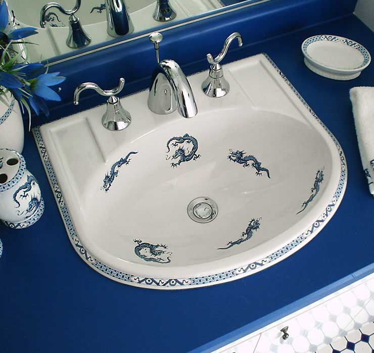 blue and white bathroom with oriental dragons painted porcelain sink