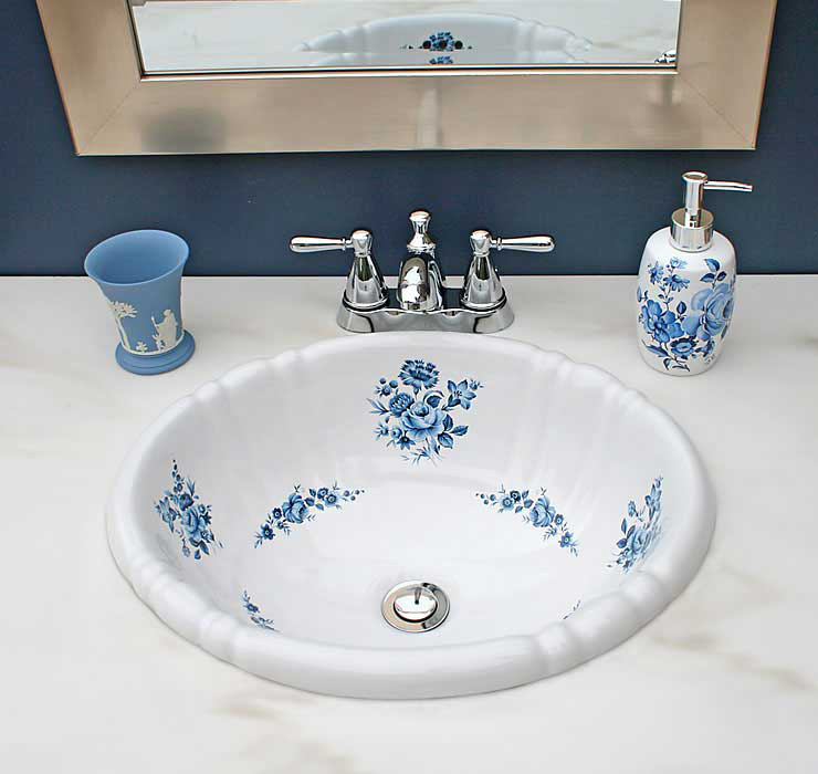 traditional navy blue bathroom with hand painted rose sink