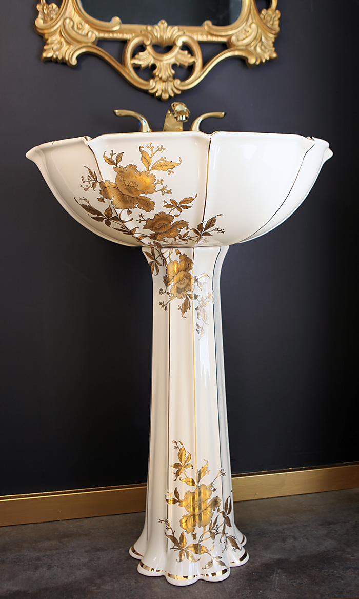 gold orchids painted pedestal sink in black and gold powder room