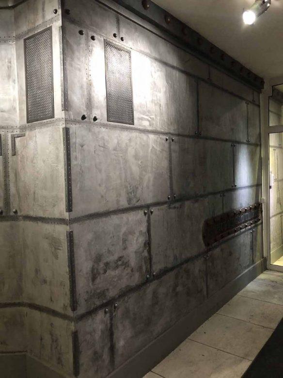 murs métal en trompe l'oeil