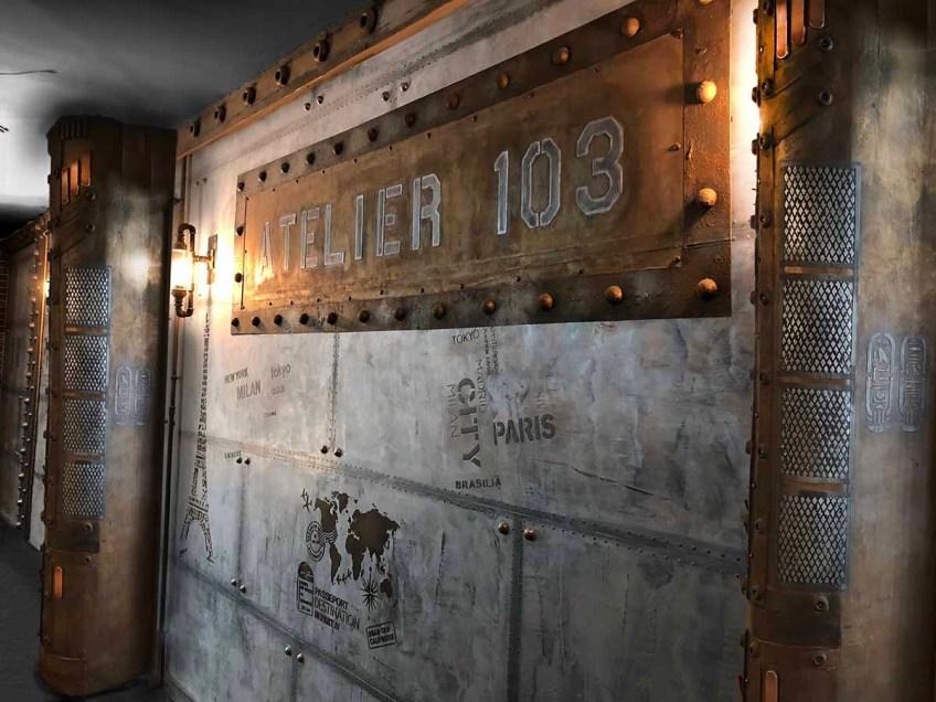 Brasserie style Eiffel des murs métal et des IPN de tradition Eiffel et une enseigne atelier 103 sur BA13