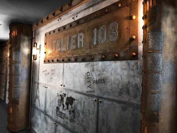 Décoration appartement Haussmannien colonne style Eiffel et mur métal