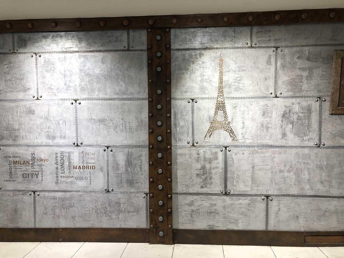 Mur métal en plaques rivetées et boulonnées plus IPN style Eiffel