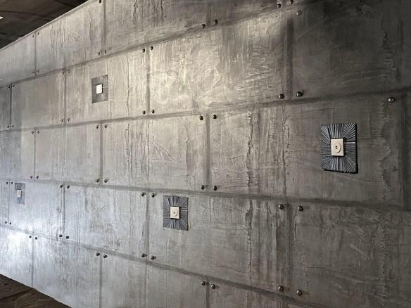 murs métal style industriel et IPN style eiffel décoration immeuble paris