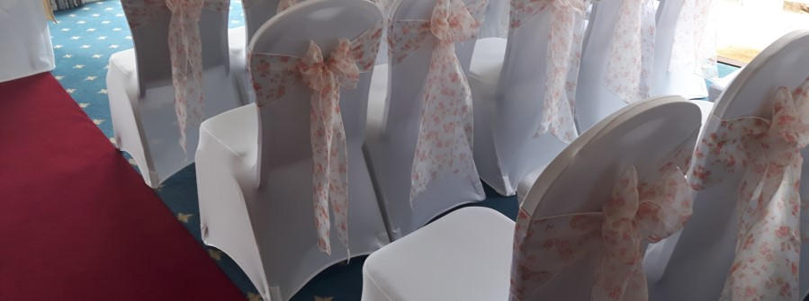 chair cover hire exeter cheap fold up chairs covers wedding devon newton abbot printed organza bows