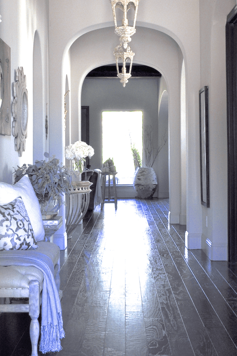Long Entry Hall with Arches and Pendant Lighting