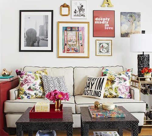 small living room design with wall arts and sofa pillows