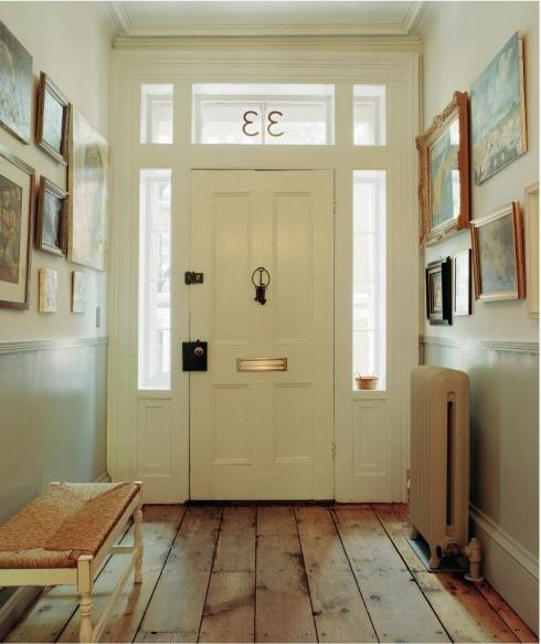 entrances/foyers - entry neutral  Via Little Green Notebook.   gorgeous front door with bench and eclectic art gallery.