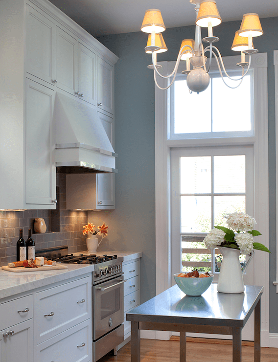 kitchens - white kitchen cabinets marble countertops gray subway tiles backsplash stainless steel island appliances chrome hardware white chandelier blue gray walls paint color kitchen