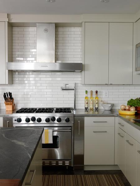 kitchens - gray modern kitchen cabinets subway tiles backsplash pot filler stainless steel countertops soapstone countertops gray walls paint color modern kitchen