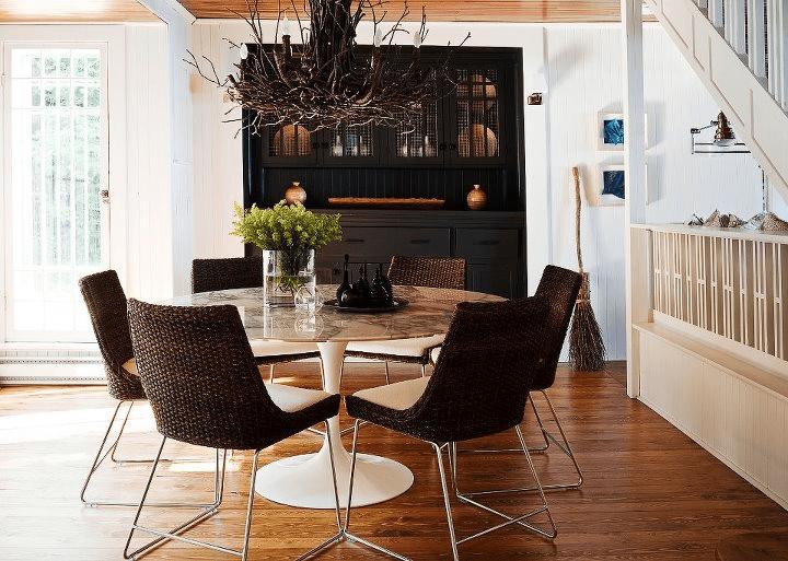 Jennifer Worts Design - Marble Saarinen tulip table, espresso wicker chairs, branch ...