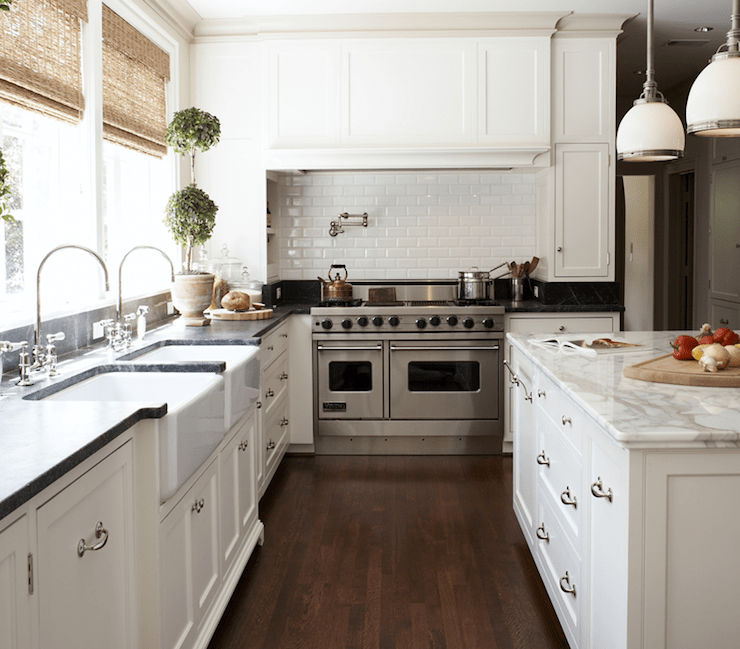 kitchens - topiaries subway tiles backsplash pot filler creamy white kitchen cabinets farmhouse sinks black marble countertops calcutta marble countertops bamboo roman shades