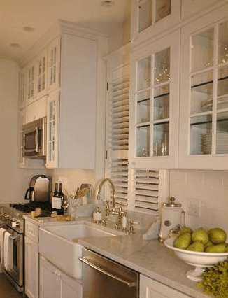 kitchens - white glass-front kitchen cabinets subway tiles backsplash white carrara marble countertops farmhouse sinks stainless steel appliances