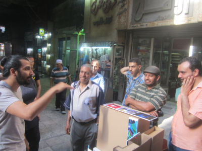 Participants explain projects idea to the shops owners in the passage