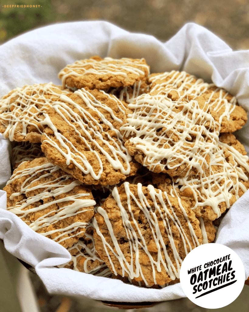 bowl of oatmeal butterscotch cookies drizzled with white chocolate