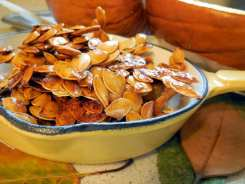 10 Top Health Benefits of Pumpkin Seeds, roasted seeds, baking pumpkins, sweet and spicy snack, crunchy snack, kid-friendly, saving pumpkin seeds, roasting, baked pumpkin, healthy snacks, crunchy, honey roasted, cayenne, squash seeds, recipe, tasty, four year old, gobble, healthy benefits, magnesium, heart-healthy, recommended daily allowance, ATP,adenosine triphosphate, energy, RNA, DNA,blood pressure, cardiac arrest, heart attack, stroke, deficient, source of, zinc, mineral depleted soils, plant-based diet, paleo, raw nuts and seeds,Plant-Based Omega-3 Fats,alpha-linolenic acid, ALA, prostate health, men's health, enlarged prostate, research, anti-diabetic effect, antioxidants, fiber, tryptophan, restful sleep, amino acid, protein building block, anti-inflammatory, pumpkin seed oil, alkaline-forming seed, tapeworms, parasites, organic, freshness, Himalayan salt, natural sea salt, instructions, snack, portable snack, grow pumpkins, nutrition, Thomas Edison, quote, cure, prevent disease, spicy, honey-roasted,