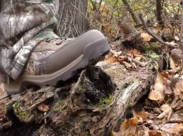 photo of the under armour brow tine 2.0 hunting boots stepping on a log