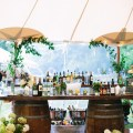 Ideas the wine casks and a rustic plank makes for an easy outdoor bar