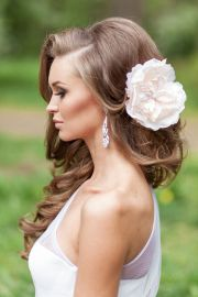 curly bridal hairstyle with blush