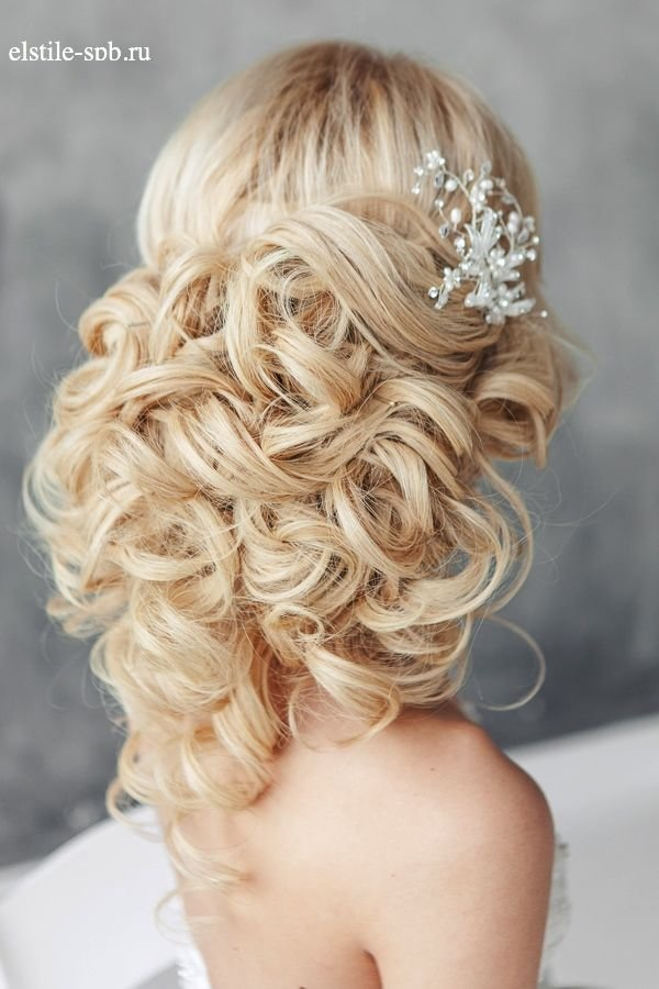 long wavy wedding updo hairstyle with hairpieces