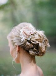 floral pinned wedding updo hairstyle