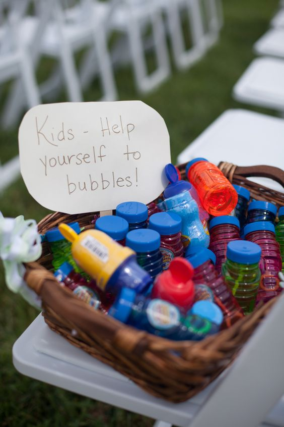 Bubbles at the outdoor wedding or reception to keep the little ones busy