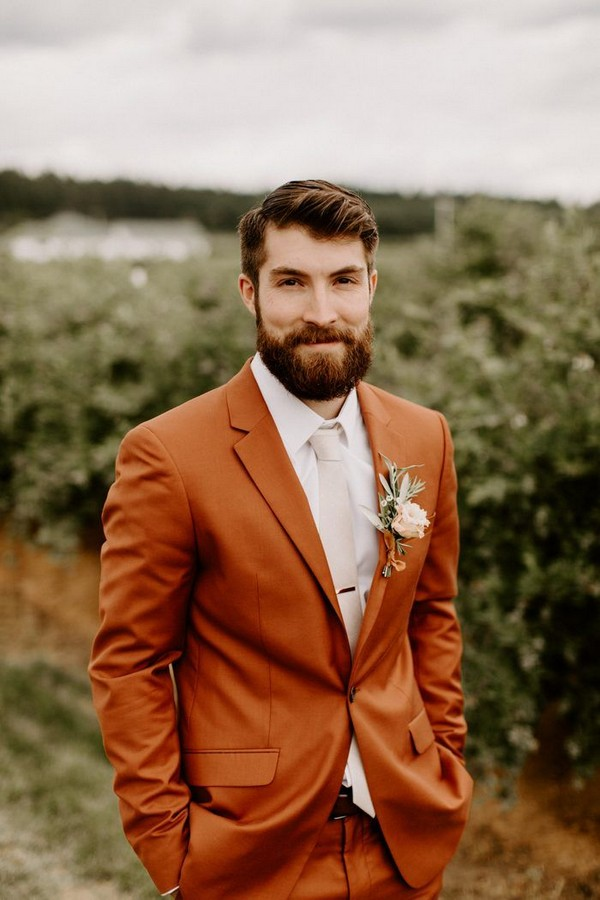 Groom went for a non-traditional look with a stunning rust-colored suit