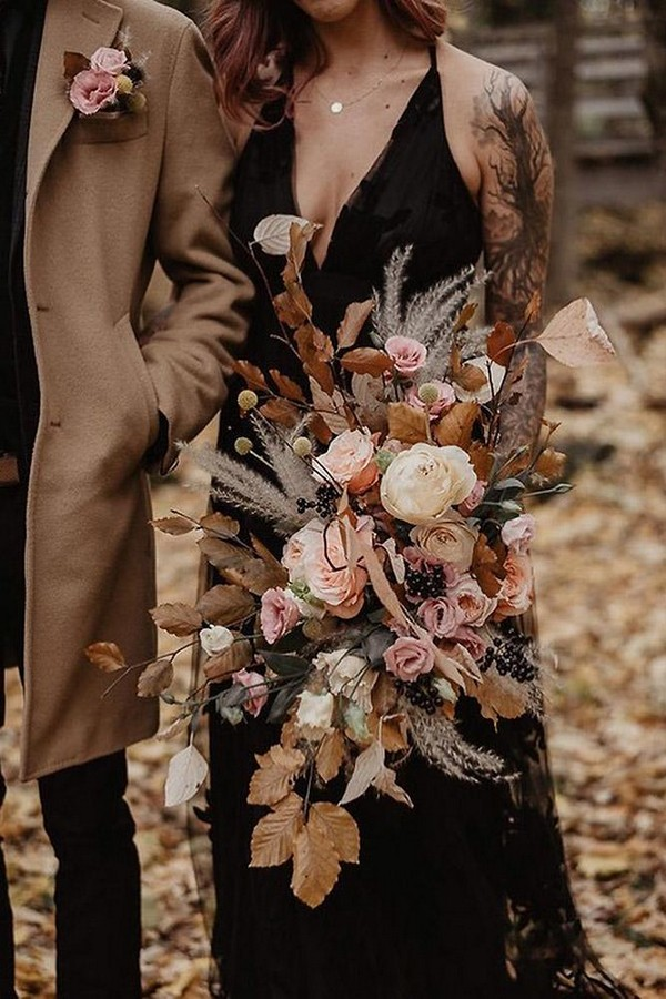 rust wedding color flower bouquet cascading with roses and leaves lesmariagesdejulia