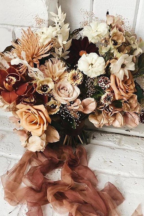rust wedding bouquet with roses and ribbons