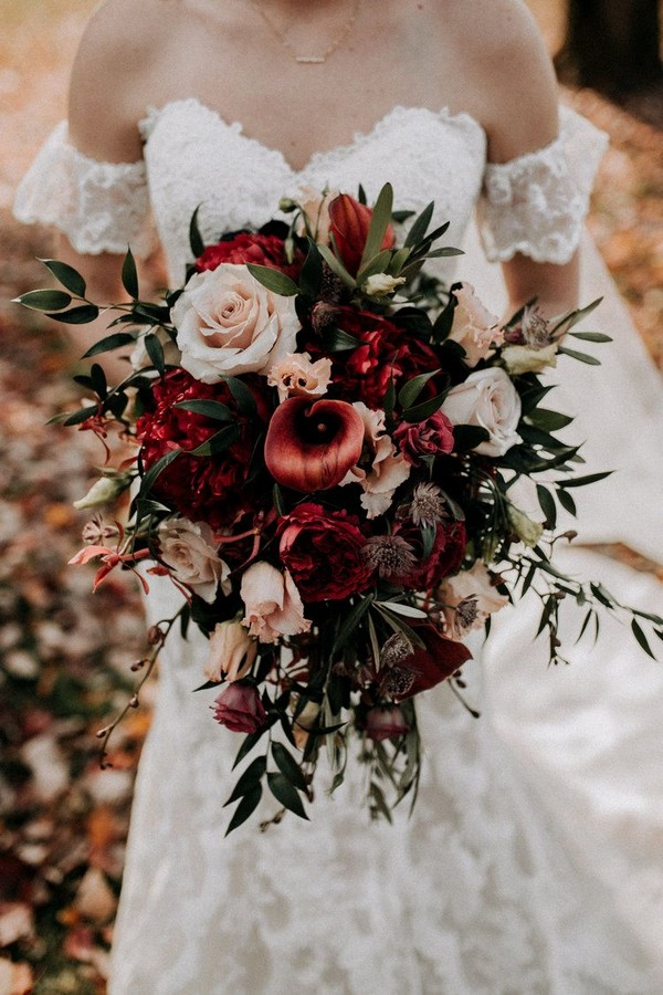 deep red and greenery fall wedding bouquet