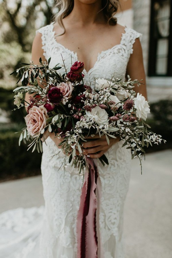 romantic and girly bridal bouquet features blush, wine, and white blooms
