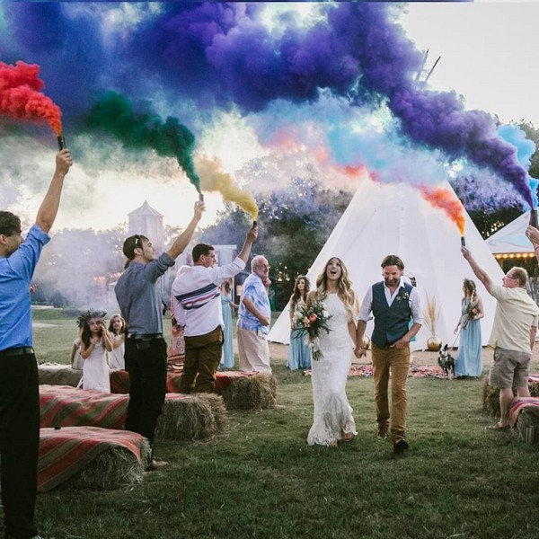wedding photo with purple green orange smoke bombs