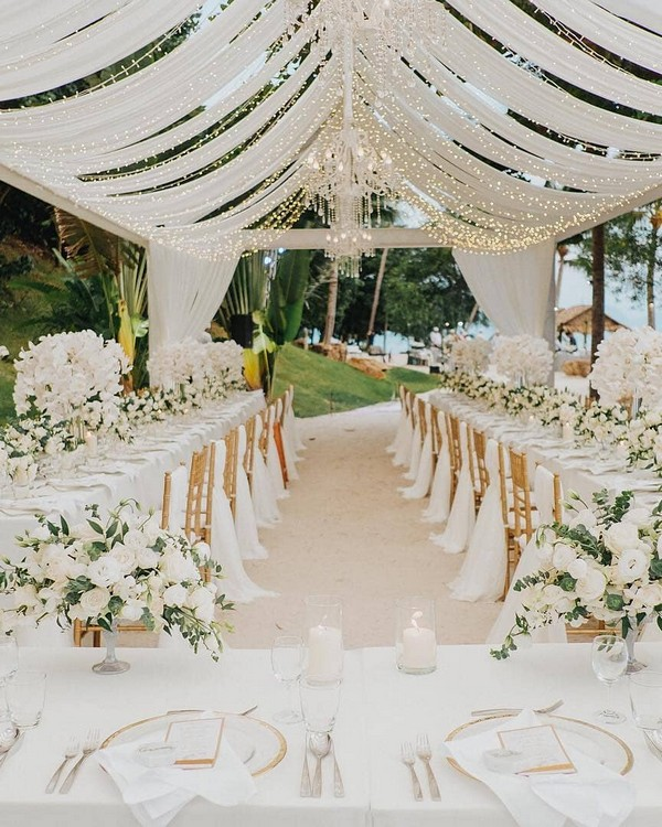 simple and greenery tented wedding reception