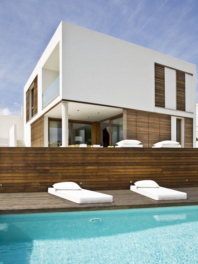 Casa minimalista sencilla y acogedora  Fachadas de Casas